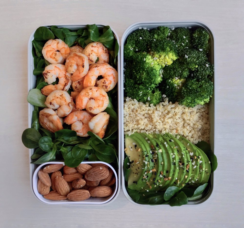 Seafood & Greens Bento - Bed of salad leaves topped with grilled shrimps (cooked with @terradelyssa_frolive oil) + white quinoa + steamed broccoli +@naturalia_magasins_bioavocado slices +@traderjoesbagel seasoning +@wonderful.francealmonds