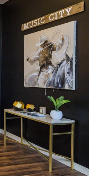 cowboy-painting-cowboystyle-cowboyinterior-musiccitysign-black-wall-sherwinwilliams-nashvilleinteriordesign-interiordesignnashville-atmosphere360studio-a360studiointeriors-interiordecorator.jpg