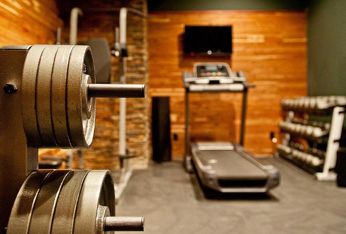 home-gym-design-wood-walls-stone-pillars-atmosphere360studio-interior-design-nashville.jpg