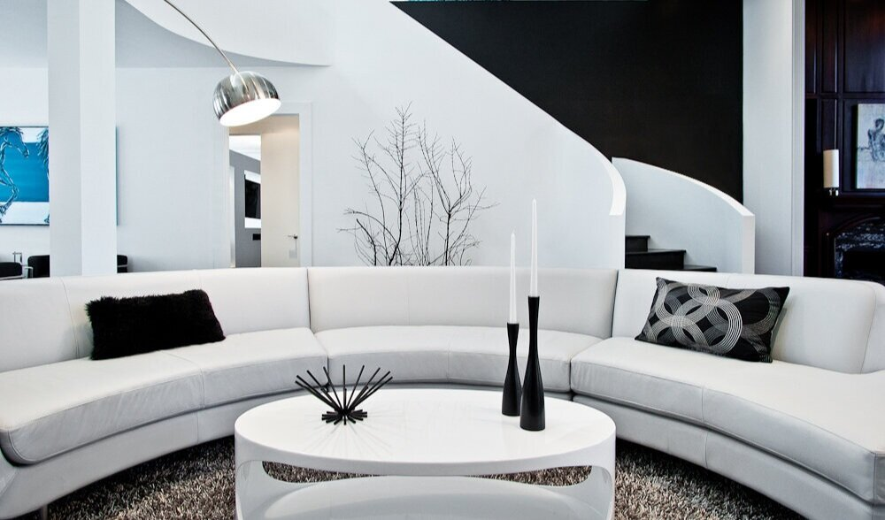 Living room with curved staircase