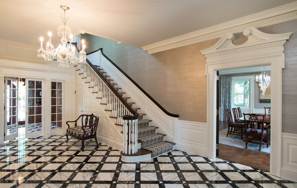 New Custom Marble Floors flow from the front door to the new french doors that lead to the gardens and pool.
