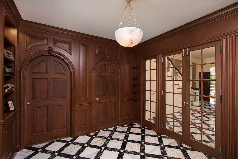 New custom doors and mill-work were designed to match the existing and seamlessly integrate the old and the new.