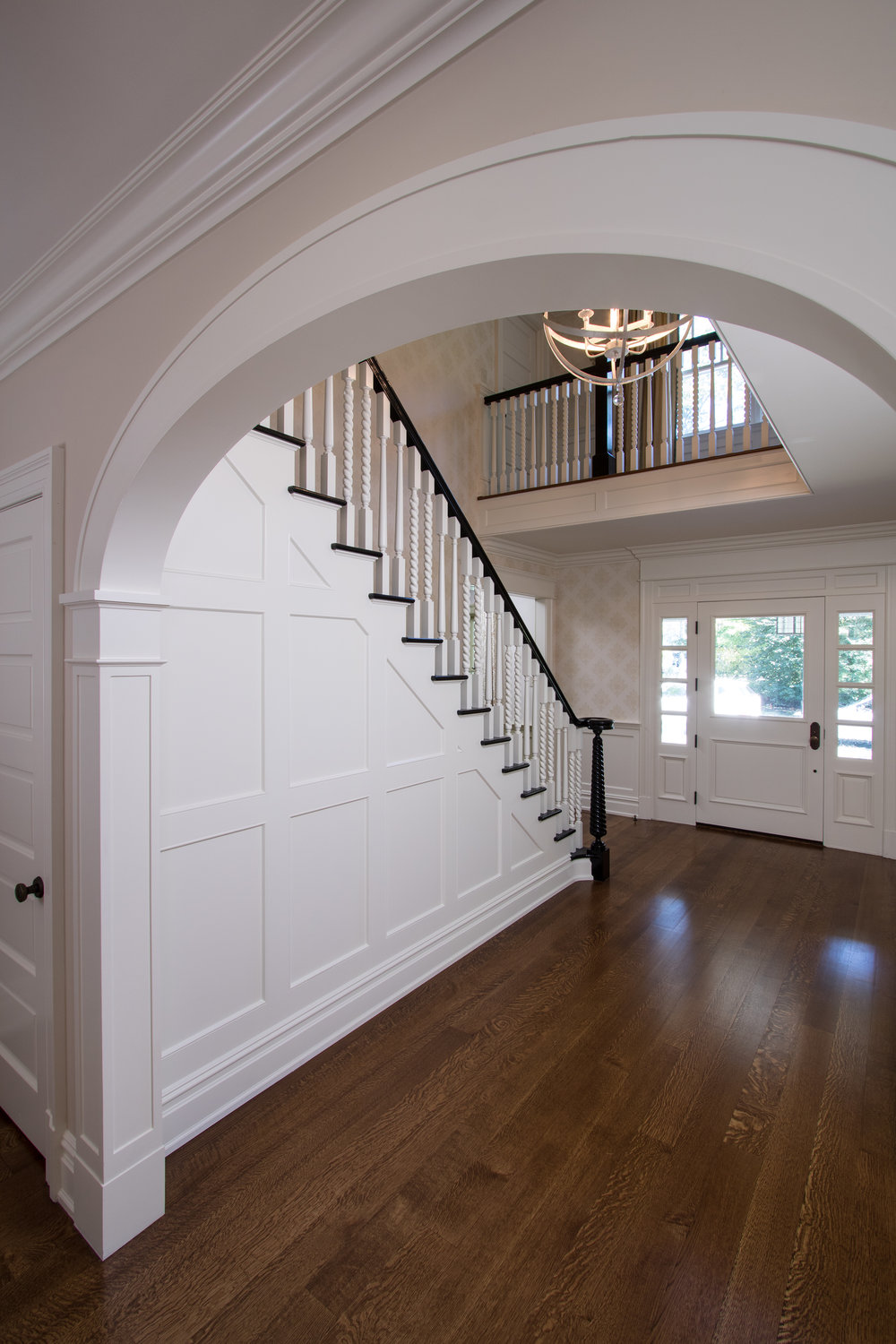 New arched openings define the reconfigured stair and foyer.