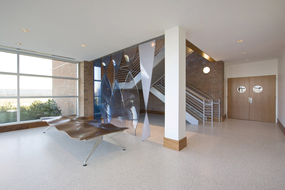 "After renovation: Overall entry and stairwell. The new entry and lobby are welcoming. Both employees and guests of the Mission find the new facility to be ""Dignified and comforting."""