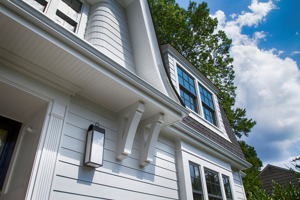 Extended gambrel overhang and bracket detail