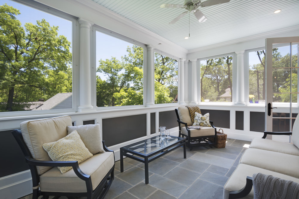 New screened in porch has a tree house feel.  Near by church bells and and views of the roof tops and tree tops make it a magical place to hang out morning noon and night.