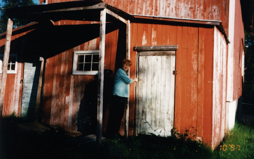 My grandma and the old red barn next to the farm house.