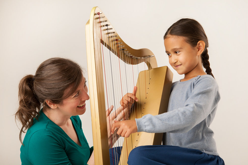 Una Ní Fhlannagain with a harp student in Ireland.