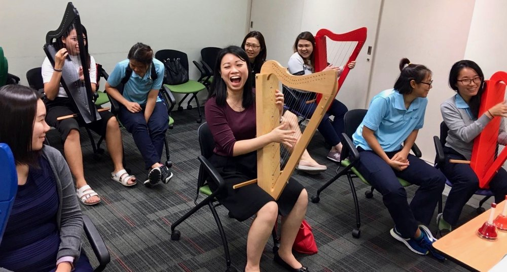 Beth Soh teaches harp at St. Luke's Hospital in Singapore.