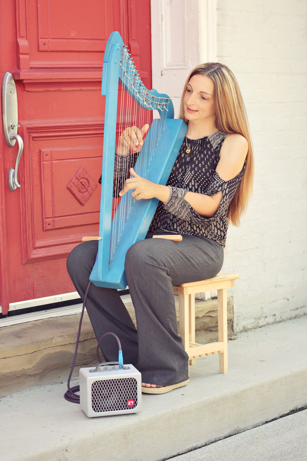 Ashley uses the Harpsicle® Harp Stick to make it easier to hold this harp at the correct height.