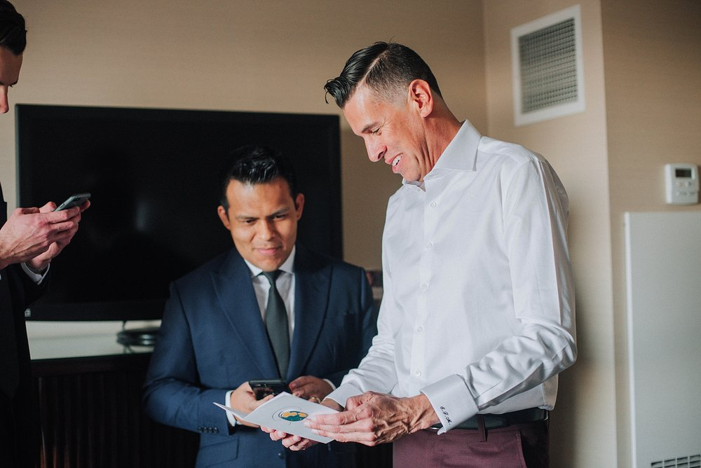 Groom opening presents, Omni Hotel Downtown Los Angeles