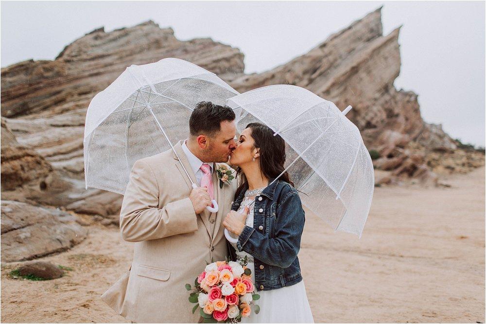 Vasquez Rocks Intimate Wedding & Elopement Photography - Bride & Groom Portraits in the rain with umbrellas