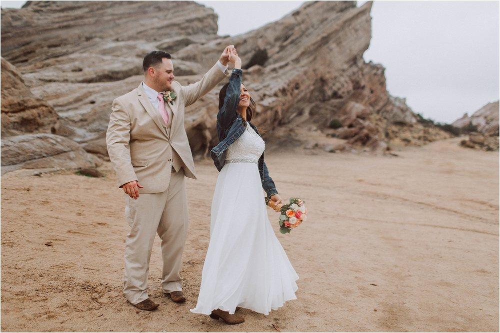 Vasquez Rocks Intimate Wedding & Elopement Photography - Bride & Groom Portraits dancing in the rain
