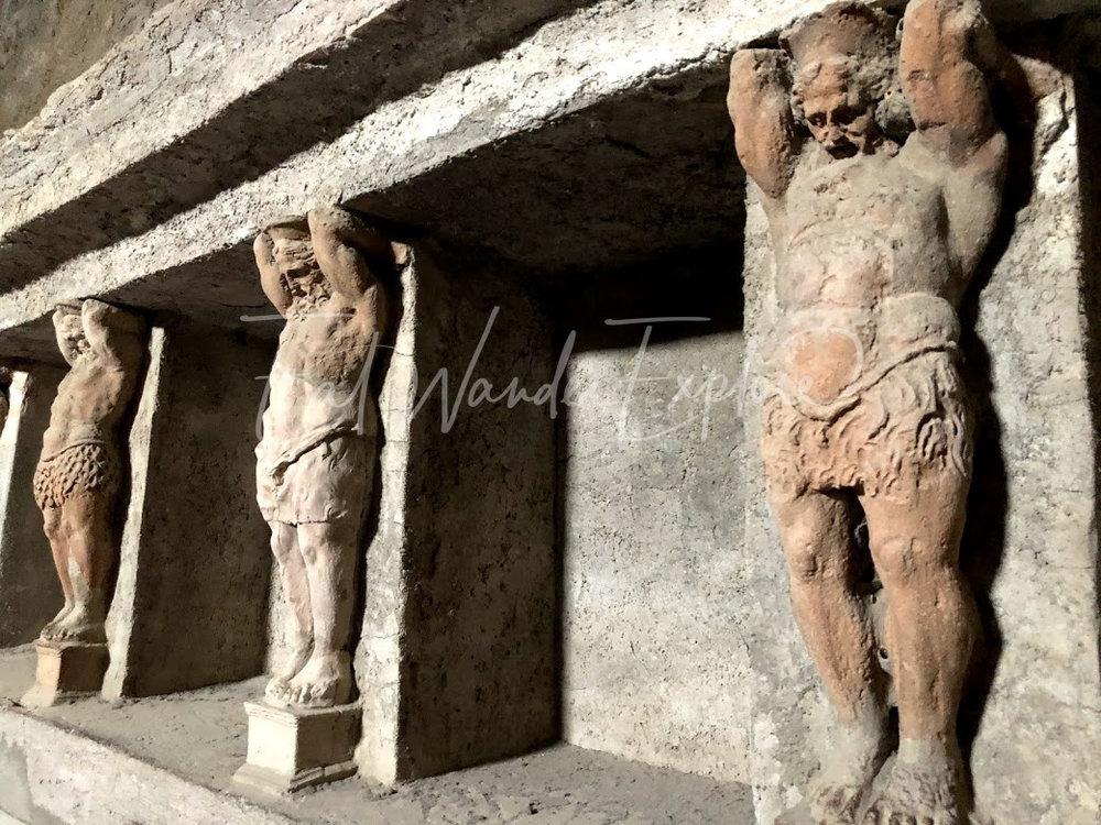 pompeii baths wall holders.jpg