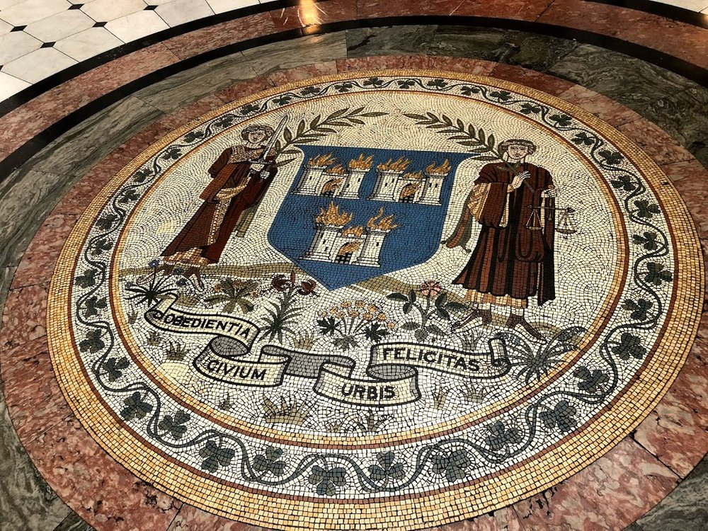 """The Obedience of the citizens produces a happy city"" mosaic in City Hall"