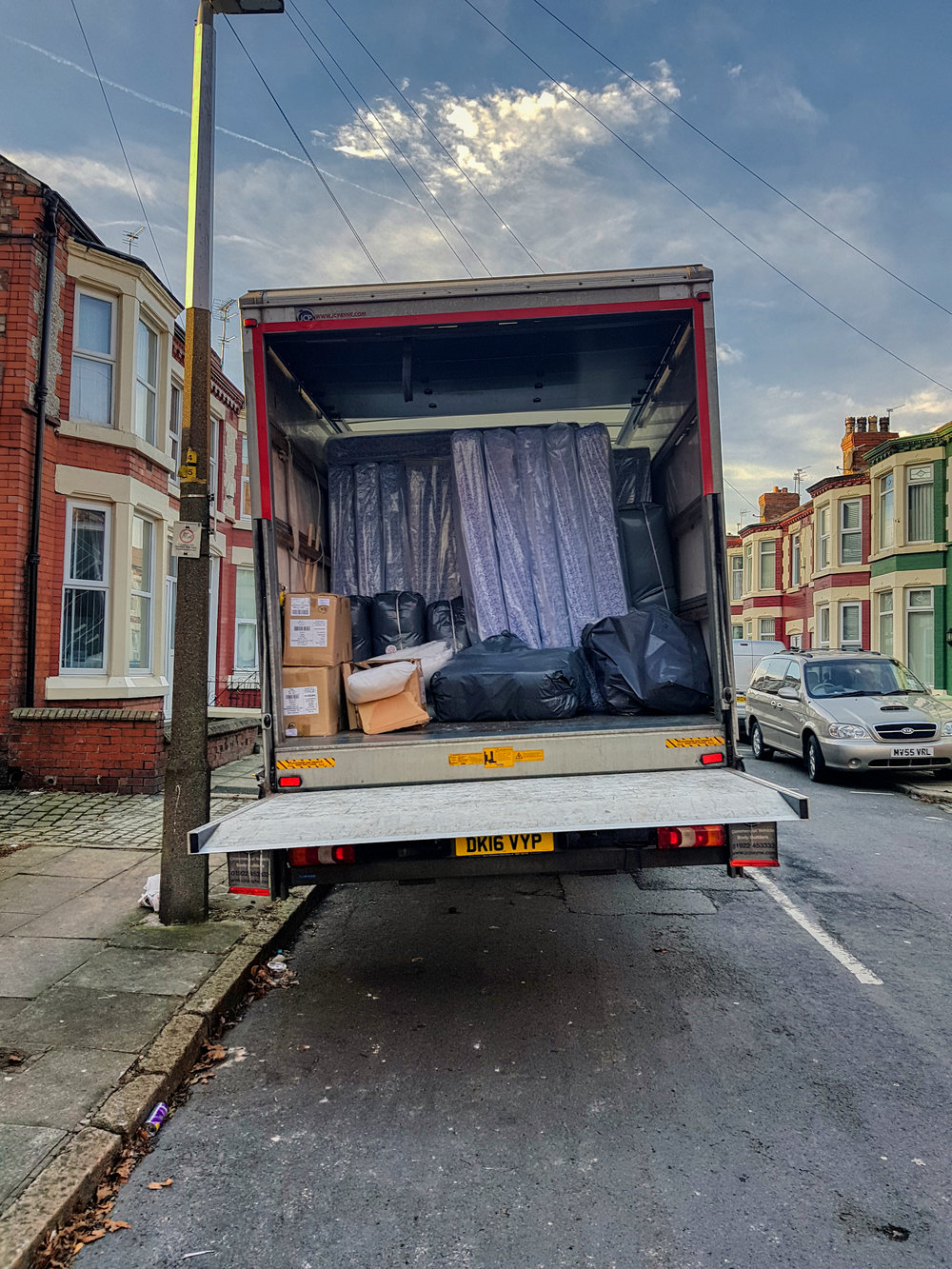 One of the vans, fully loaded, out delivering beds