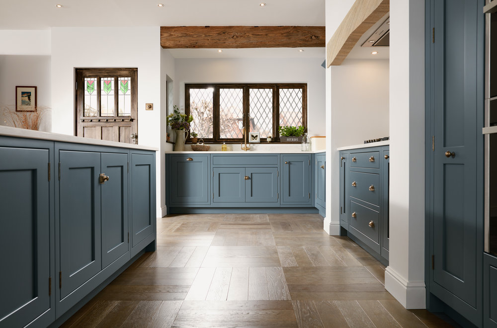 Shaker  - Shaker, an enduring familiar look, works well within a traditional or modern home. Shown here in Storm Blue, this kitchen is designed to work hard, whether for cooking, entertaining, or just enjoying a relaxing drink. The layout maximises the use of furniture without compromising on space, whilst a peninsular offers generous storage and additional breakfast bar.