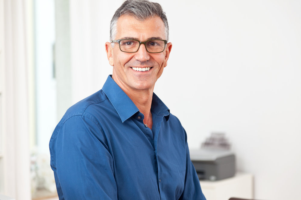 Attractive older man smiling after having dental implants