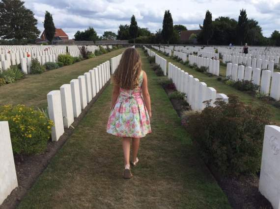 Rebecca walking through Tyne Cot in the afternoon after the official ceremony