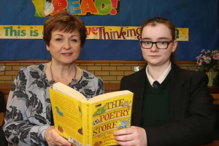 "St Patrick's College student Maeve Loney who has won a poetry competition organised by the charity ""Never Such Innocence"" to commemorate Word War 1. Maeve's poem entitled 'No Poppies in the Sand' has won a trip to London for her and her English teacher Mrs Dempsey."