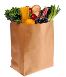 Grocery bag full of whole grains, vegetables, fruits
