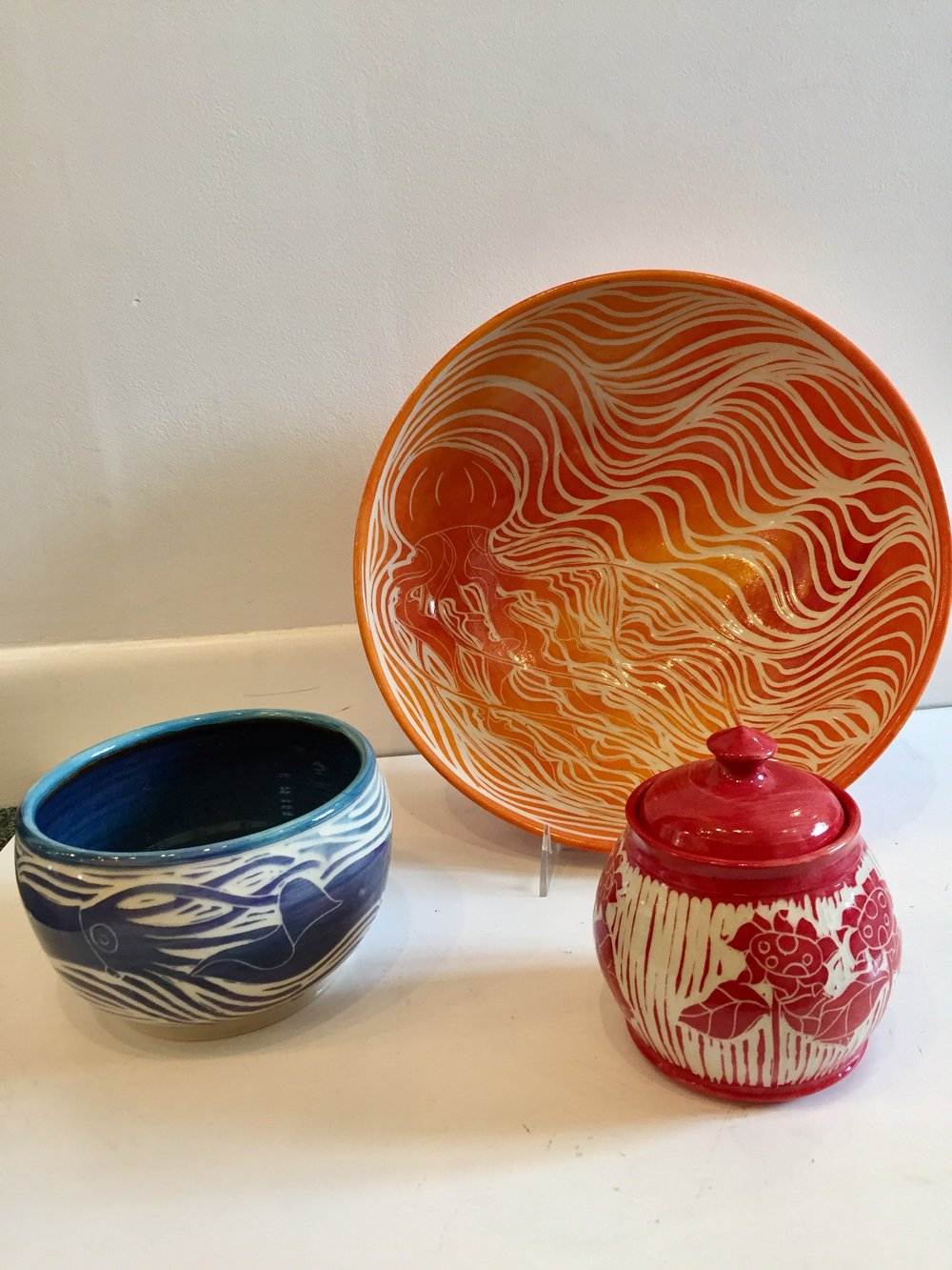 - Sarah Caruso CeramicsSarah's work has been inspired by her own back yard here on the Cape.  As she carves images of plants and saline using the sgrafitto technique, the beauty of her colors and skills capture your attention.  She creates bowls, mugs and various other beautiful pieces for your use and enjoyment.