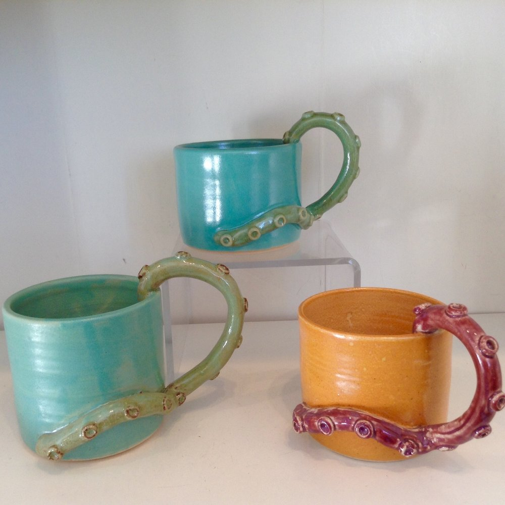 - Thrown Worthy CeramicsZoe Prior-Grosch has created the tentacle mug in wonderful glazes of aqua and orange.  They are comfortable and easy to hold.