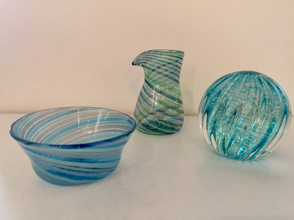 - Sayuri Kingsury GlassSayuri began blowing glass at 18 years old in Japan.  She lives here on Cape Cod and creates lively, small vases, paperweights, and ornaments of many beautiful colors and shapes.