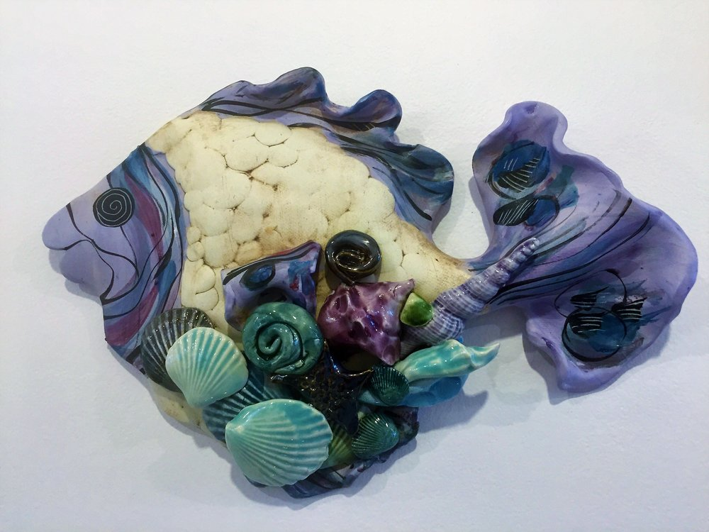 - Clayborn PotteryArtist Nancy Salamon creates beautiful, fancy fish for your wall decor.  Her glaze colors are very muted and soft and will brighten any wall.