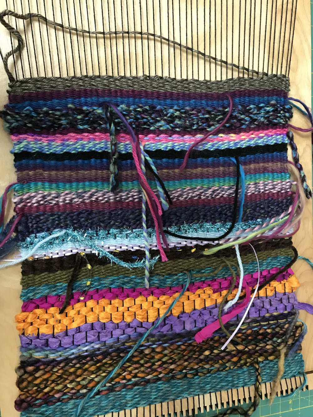 Photo credit and work by Lindsay F., Midwest Fiber Arts Trails 2018 workshop participant, completed on the placemat loom by Purl & Loop.