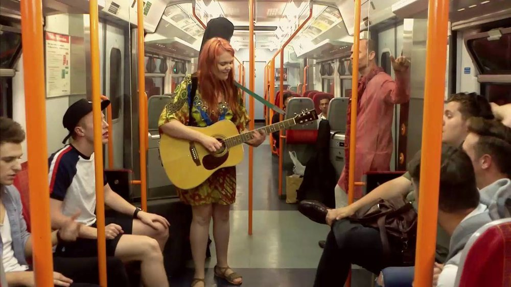 friday night live / 1st march - this is mary-grace dineen, 3 years ago she lost her oyster while travelling the overground, she's busking to help get out, hopefully she'll have enough cash by march the 1st.