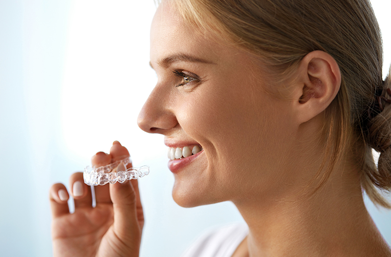 Invisible clear braces provide a straight smile without the metal wire and brackets.