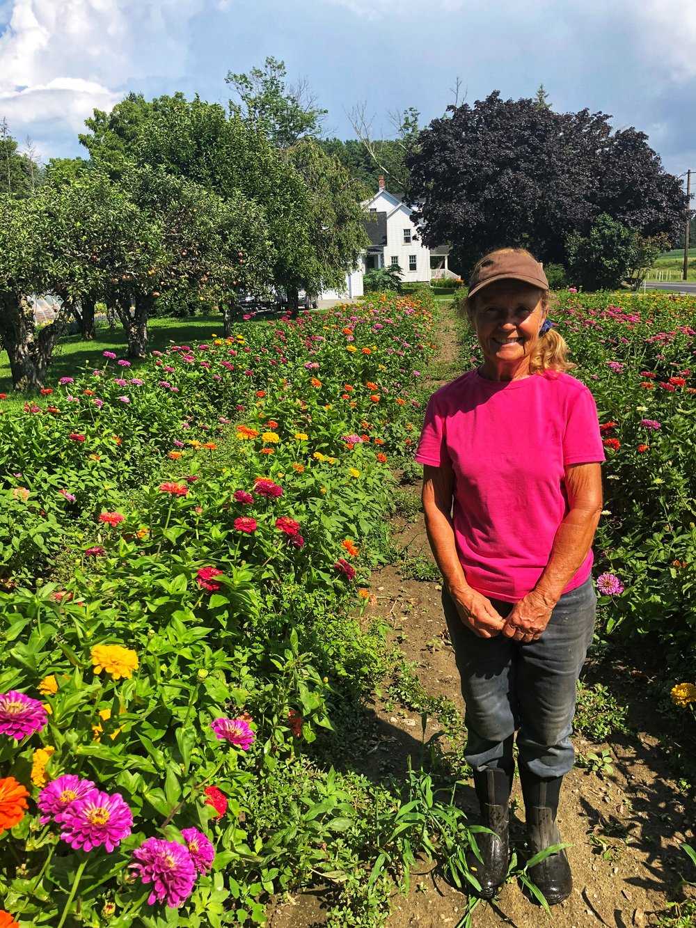 Susan Macone in her field of flowers.