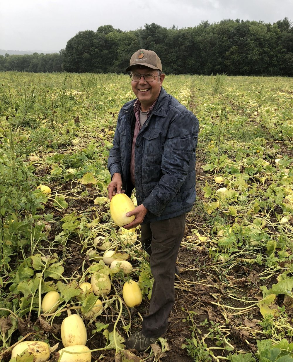 Wally Czajkowski in his field of (delicious!) spaghetti squash.