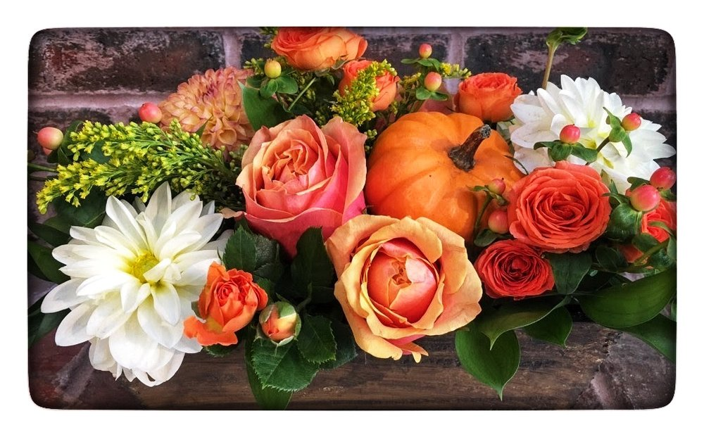 Our Pumpkin Wooden Flower Box with shades of orange, white and yellow plus a baby pumpkin!