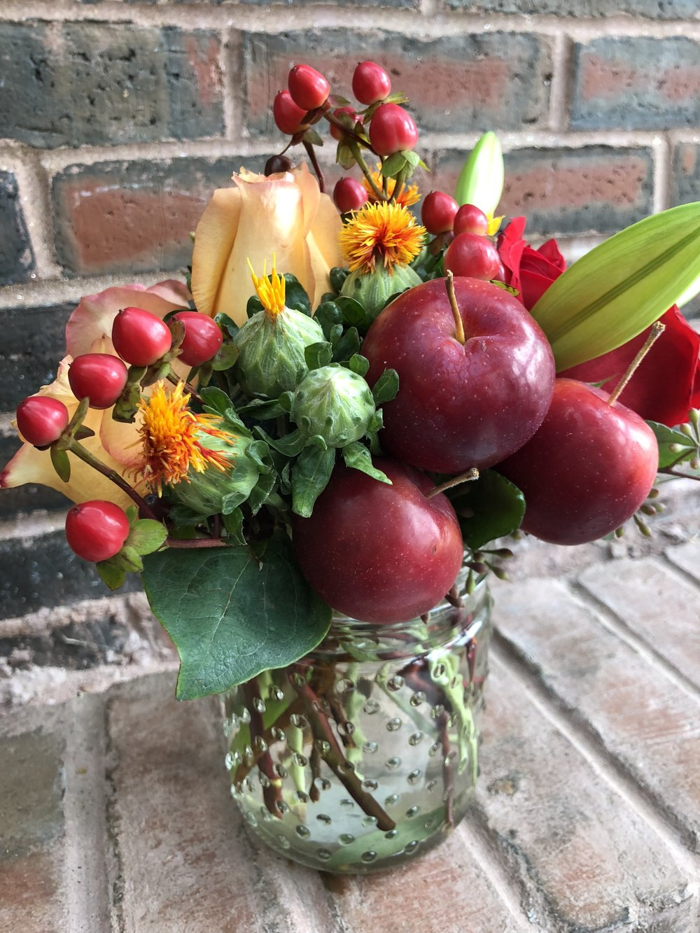 Flower arrangements made with flowers and crab apples!