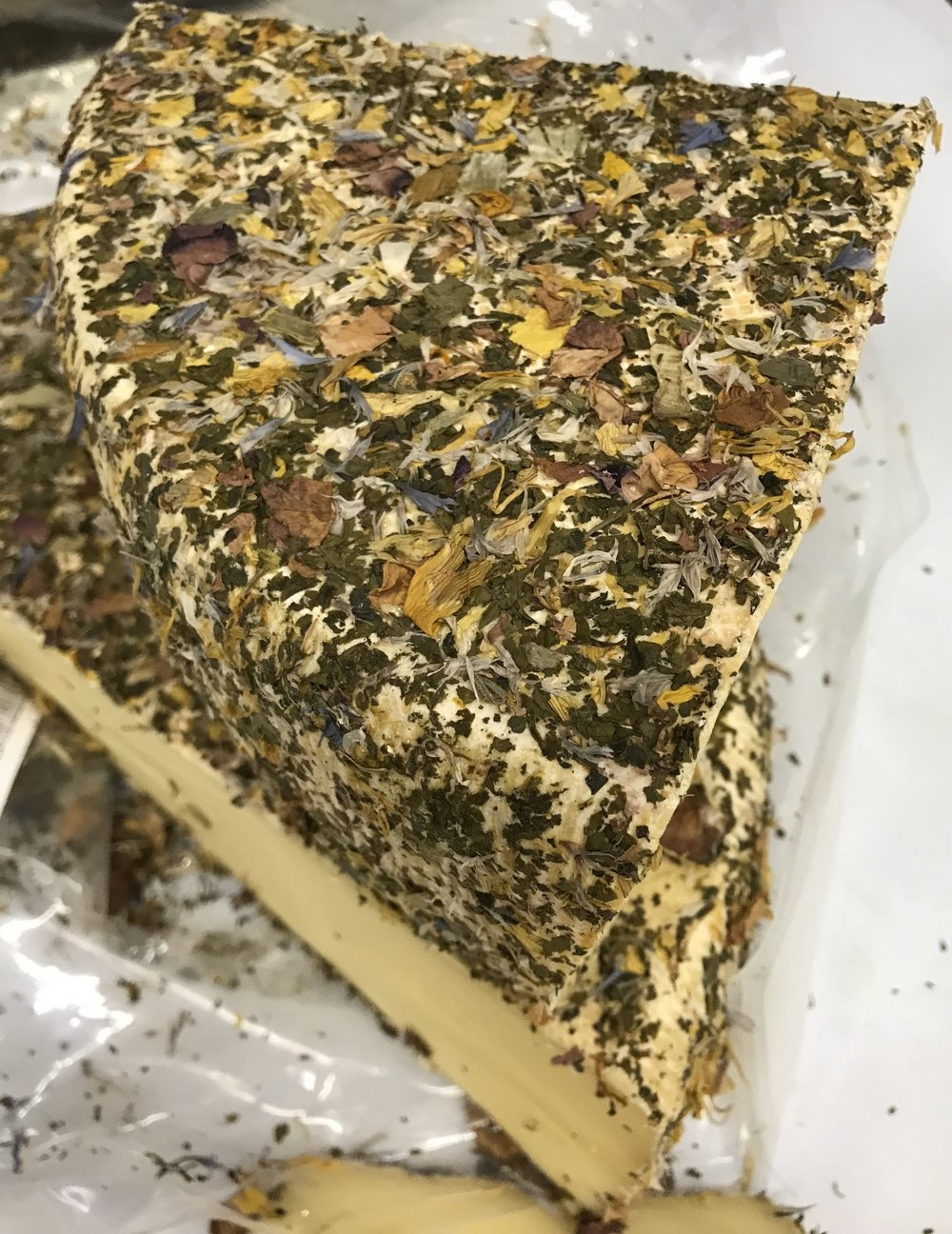 Gorgeous and delicious Hay Flower cheese available now at Russo's!