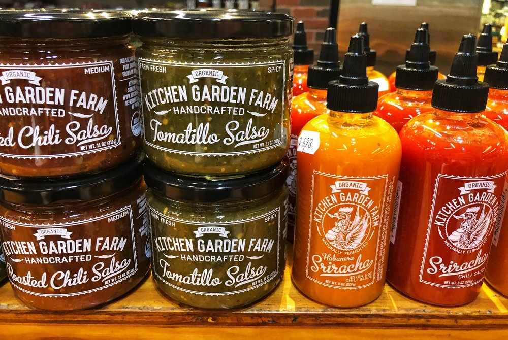Kitchen Garden Farm's delicious organic handcrafted Salsas and Srirachas at Russo's.
