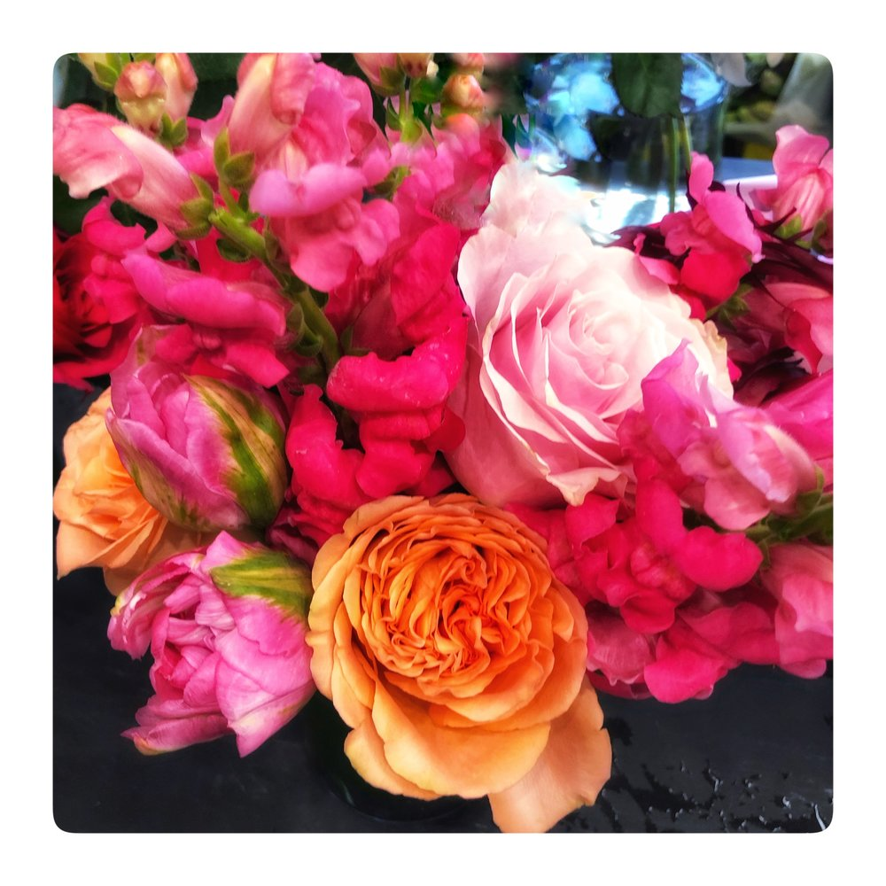 Spring flowers bouquets with pinks and corals.