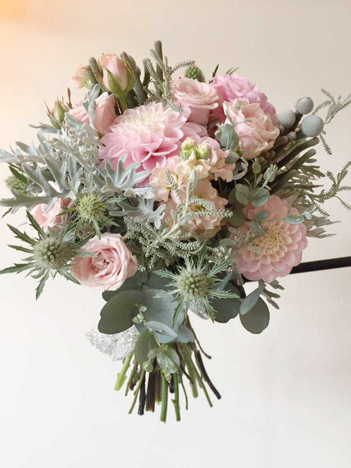 This bouquet was the most liked at the Wedding Fayre and on Facebook. Soft pastel pink flowers, grey foliage and silver lace ribbon in a simple bow looks so pretty.