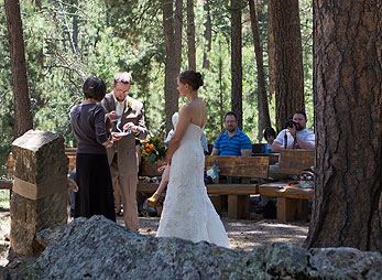 Couple exchange vows in the outdoor chapel at Bluebell Lodge