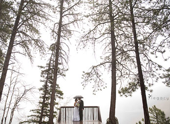 Happy newlyweds on the scenic deck at Sylvan Lake Lodge in Custer State Park