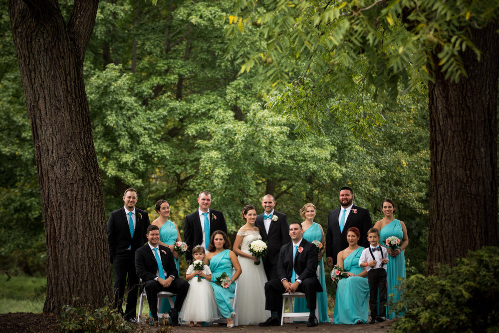 Wedding party posed outdoors in Delaware