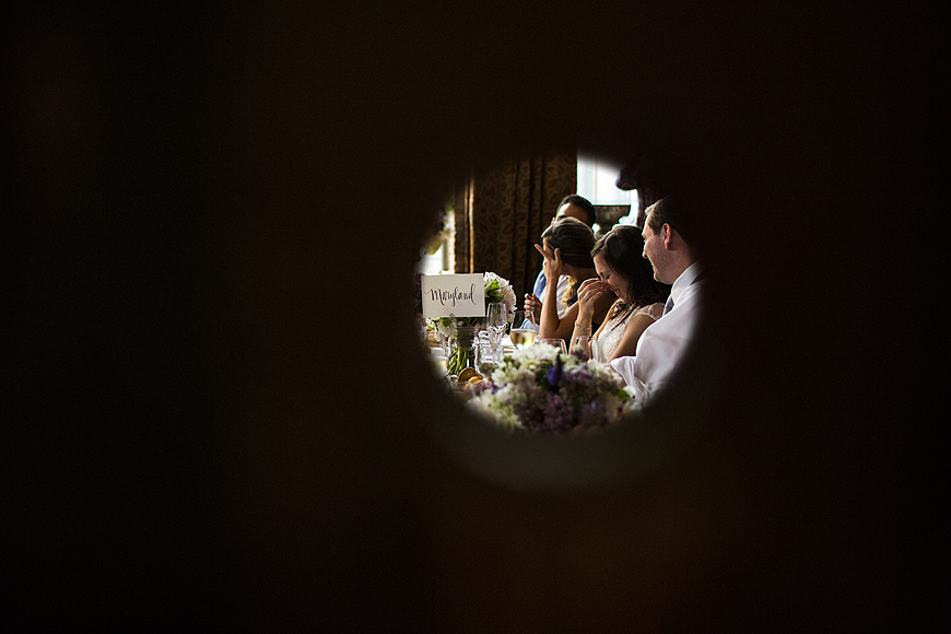 Wedding moment at Woodberry Kitchen captured through a pinhole