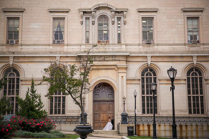 Bride and groom posing in a doorway in Mount Vernon Baltimore Maryland