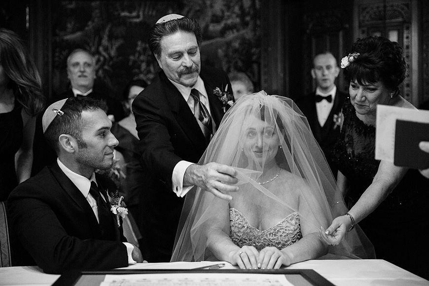 Bride about to have her veil lifted by her parents during a Jewish wedding ceremony at the Engineers Club