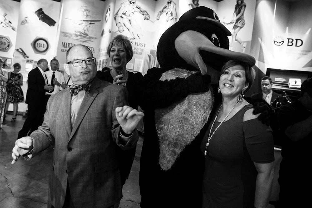 Oriole bird pretending to eat head of wedding guest at Baltimore wedding