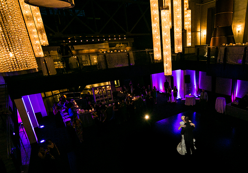 Bride and groom dancing at their wedding at the Phoenixville Foundry amidst purple uplighting
