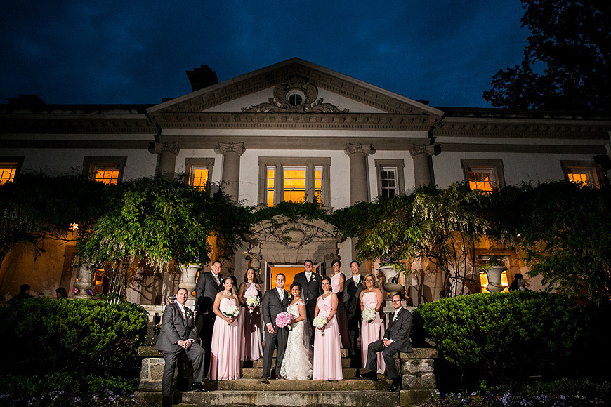 Wedding party at night outside of the Liriodendrum Mansion in Bel Air Maryland