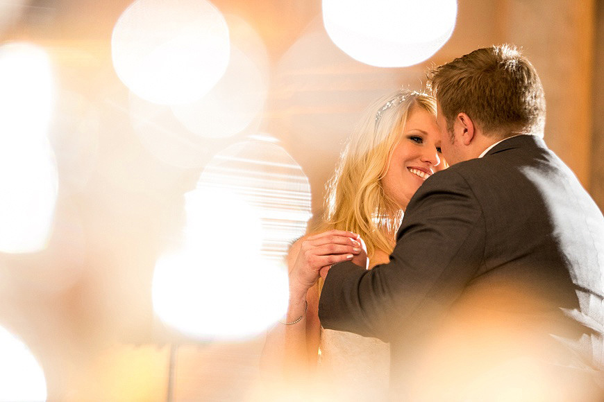 Bride and groom dancing and surrounded by lights at the Baltimore Grand Historic Venue